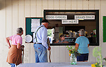 Young waiter at 4-H food booth at Cheshire Fair in Swanzey, New Hampshire USA