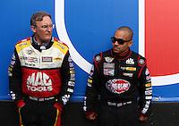 Feb 22, 2015; Chandler, AZ, USA; NHRA top fuel driver J.R. Todd (right) with Doug Kalitta during the Carquest Nationals at Wild Horse Pass Motorsports Park. Mandatory Credit: Mark J. Rebilas-