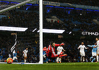 Swansea City goalkeeper Lukasz Fabianski is unable to stop the shot from Yaya Toure of Manchester City to make the score 2-1 during the Barclays Premier League match between Manchester City and Swansea City played at the Etihad Stadium, Manchester on December 12th 2015