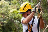 Man in safety helmet preparing to go Ziplining on the Big island with Kohala zipline