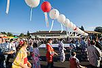 Particpants perform traditional Japanese dance under paper lanterns at the Obon Festival at Oregon Buddhist Temple, Portland, Oregon