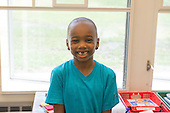 MR / Schenectady, NY. Zoller Elementary School (urban public school). Kindergarten classroom. Portrait of student (boy, 5). As is typical for his age, he has lost his two front baby teeth. MR: Abd2. ID: AM-gKw. © Ellen B. Senisi.