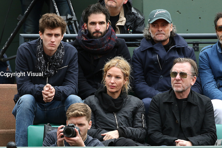 Jean-Baptiste Maunier, Nikki Butler and Tim Roth watching tennis at Roland Garros tennis open 2016. Paris - may 23. 2016.
