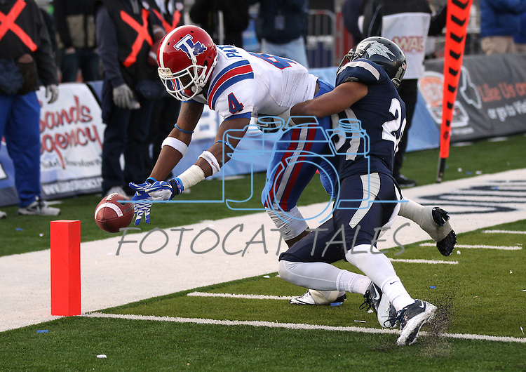 Louisiana Tech's Quinton Patton (4) scores a touchdown against Nevada defender Isaiah Frey (28)in the fourth quarter of an NCAA football game Saturday, Nov. 19, 2011, in Reno, Nev. The play was reviewed and upheld, leading to a 24-20 Louisiana Tech victory. (AP Photo/Cathleen Allison)