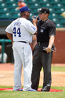 Chattanooga Lookouts manager Razor Shines (44) has a heated discussion with home plate umpire Garrett Patterson after picther Blake Smith (not pictured) was ejected for hitting a Montgomery Biscuits batter at AT&T Field on July 23, 2014 in Chattanooga, Tennessee.  The Lookouts defeated the Biscuits 6-5. (Brian Westerholt/Four Seam Images)