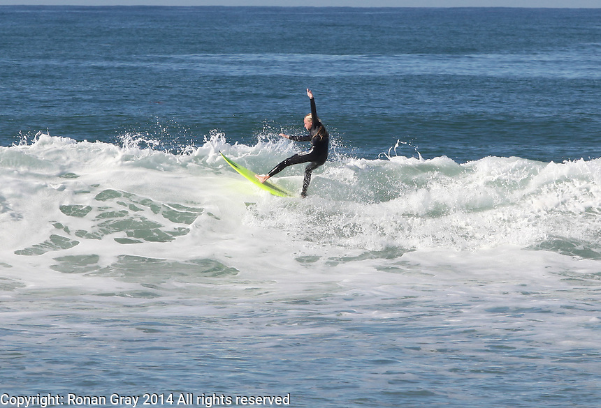 Mission Beach San Diego CA, USA.  22nd November,  2014:  Mission Bay High School Surf Team member Ciara Gray warms up between heats.  The team competed in the Scholastiac Surf Series High School Contest at San Fernando place.
