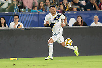 CARSON, CA - SEPTEMBER 21: Julian Araujo #22 of the Los Angeles Galaxy looks for an open man during a game between Montreal Impact and Los Angeles Galaxy at Dignity Health Sports Park on September 21, 2019 in Carson, California.