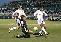 Abby Wambach (20) of the Washington Freedom sends the ball past Ella Masar#3 and Chioma Igwe (12) of the Chicago Red Stars during a WPS match at Maryland Soccerplex on April 11 2009, in Boyd's, Maryland.  The game ended in a 1-1 tie.