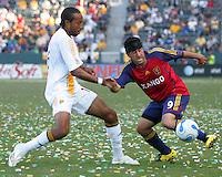 Real Salt Lake FWD Alecko Eskandarian (9) attempts to dribble around LA Galaxy DEF Quavas Kirk (15) during a MLS match. The LA Galaxy beat Real Salt Lake 3-2 at the Home Depot Center in Carson, California, Sunday, June 17, 2007.