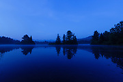 Coffin Pond in Sugar Hill, New Hampshire USA at morning blue hour during the summer months.