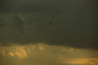 Helicopters fly above Sao Paulo.