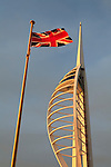 United Kingdom, England, Hampshire, Portsmouth: Gunwharf Quays, Spinnaker Tower and Union Jack at sunset