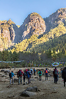 Paro, Bhutan.  Hikers at the Trailhead Starting the Climb to the Tiger's Nest Monastery (Middle top).