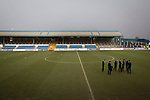 Greenock Morton 2 Stranraer 0, 21/02/2015. Cappielow Park, Greenock. Visiting players wearing suits inspect the pitch before Greenock Morton take on Stranraer in a Scottish League One match at Cappielow Park, Greenock. The match was between the top two teams in Scotland's third tier, with Morton winning by two goals to nil. The attendance was 1,921, above average for Morton's games during the 2014-15 season so far. Photo by Colin McPherson.