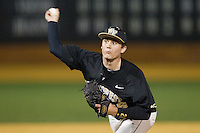 Wake Forest Demon Deacons relief pitcher Garrett Kelly (28) in action against the Georgetown Hoyas at Wake Forest Baseball Park on February 16, 2014 in Winston-Salem, North Carolina.  The Demon Deacons defeated the Hoyas 3-2.  (Brian Westerholt/Four Seam Images)