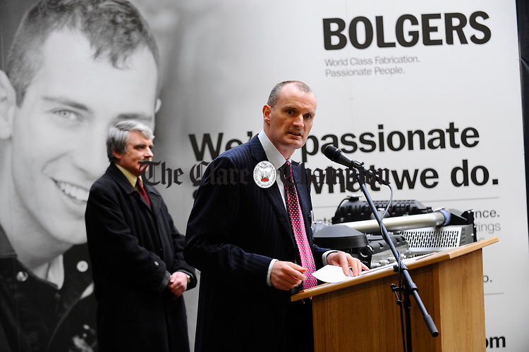 Ian Bolger, joint managing director of Bolgers, Smithstown, Shannon, speaking at then presentation of the Silver Certificate for Caterpillar's Supplier Quality Excellence Process to the company. Looking on is Minister Willie O Dea. Photograph by John Kelly.