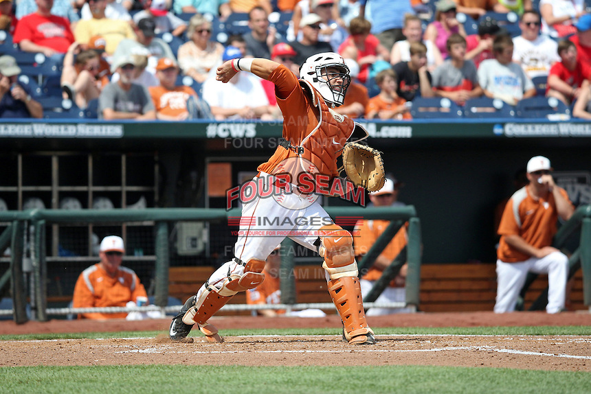 Tres Barrera #1 of the Texas Longhorns throws during Game 1 of the 2014 Men's College World Series between the UC Irvine Anteaters and Texas Longhorns at TD Ameritrade Park on June 14, 2014 in Omaha, Nebraska. (Brace Hemmelgarn/Four Seam Images)