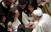Papa Francesco saluta le coppie di sposi novelli al termine dell'Udienza Generale del mercoledi' in aula Paolo VI in Vaticano, 28 dicembre 2016.<br /> Pope Francis greets newly married couple at the end of his weekly general audience in Paul VI Hall at the Vatican on December 28, 2016. <br /> UPDATE IMAGES PRESS/Isabella Bonotto<br /> <br /> STRICTLY ONLY FOR EDITORIAL USE