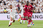 Almoez Ali of Qatar (R) fights for the ball with Ali Hassan Ali Salmin of United Arab Emirates (L) during the AFC Asian Cup UAE 2019 Semi Finals match between Qatar (QAT) and United Arab Emirates (UAE) at Mohammed Bin Zaied Stadium  on 29 January 2019 in Abu Dhabi, United Arab Emirates. Photo by Marcio Rodrigo Machado / Power Sport Images