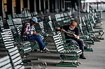 June 3, 2021: Fans peruse their options as they try to pick a winner during Thursday at the Belmont Stakes Festival at Belmont Park in Elmont, New York. Scott Serio/Eclipse Sportswire/CSM