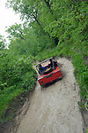 Land Rover based off-road racer at the ALRC National 2008 CCVT trial driving through flooded forest road after torrential rain. The Association of Land Rover Clubs (ALRC) National Rallye is the biggest annual motor sport oriented Land Rover event and was hosted 2008 by the Midland Rover Owners Club at Eastnor Castle in Herefordshire, UK, 22 - 27 May 2008. --- No releases available. Automotive trademarks are the property of the trademark holder, authorization may be needed for some uses.