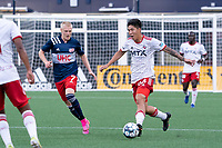 FOXBOROUGH, MA - JUNE 26: Connor Presley #7 of the New England Revolution pressures Kazu #88 of North Texas SC during a game between North Texas SC and New England Revolution II at Gillette Stadium on June 26, 2021 in Foxborough, Massachusetts.