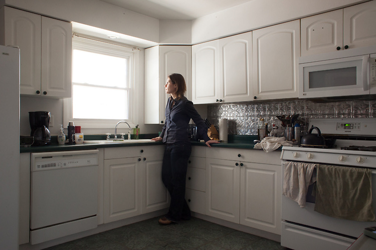 A self-portrait of me in the kitchen just before I leave to get my two sons from school. My husband frequently works a late shift, meaning that I am on my own with the boys.