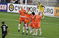 Julianne Sitch (38), Yael Averbuch (10), Sarah Walsh (8) and Kelly Parker (7) jump up against Tiffany Weimer's (8) kick. FC Gold Pride vs Sky Blue FC at Buck Shaw Stadium in Santa Clara, California on May 3, 2009
