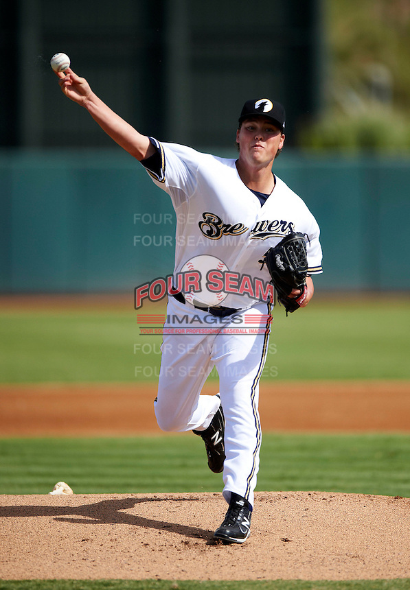 Phoenix Desert Dogs pitcher Jimmy Nelson #57, of the Milwaukee Brewers organization, during an Arizona Fall League game against the Surprise Saguaros at Phoenix Municipal Stadium on October 18, 2012 in Phoenix, Arizona.  The game was called after eleven innings with a 2-2 tie.  (Mike Janes/Four Seam Images)