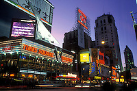 New York City, Manhattan, New York, Time Square illuminated at night along Broadway in Midtown Manhattan.