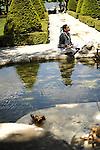 Ballet Hispanico dancer Melissa Fernandez relaxes with her journal in the garden of the Pocantico Center's Kykuit Estate near Tarrytown in the Hudson Valley.