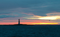 A pastel sunset backdrops Jussarö Lighthouse on a rocky  skerry situated 2.5 miles south of Jussarö Island in the Gulf of Finland.