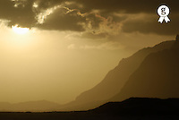 Sunset on mountains, by coastal landscape (Licence this image exclusively with Getty: http://www.gettyimages.com/detail/94433138 )