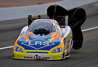 Nov. 1, 2008; Las Vegas, NV, USA: NHRA funny car driver Tim Wilkerson slows down after his run during qualifying for the Las Vegas Nationals at The Strip in Las Vegas. Mandatory Credit: Mark J. Rebilas-