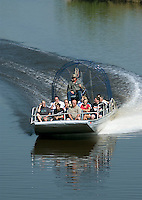 An airboat tour group returns from a trip down the Kissimmee River in central Florida in Apri