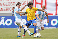 Brazil defender Marcelo (6) goes against  Argentina forward Gonzalo Higuain (9) The Argentina National Team defeated Brazil 4-3 at MetLife Stadium, Saturday July 9 , 2012.
