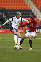 10th October 2020, The Hive, Canons Park, Harrow, England; A battle for possession by Leah Galton Manchester United during for womens Super League game between Tottenham Hotspur and Manchester United