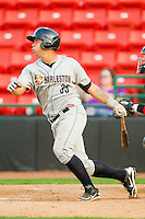 Gary Sanchez #35 of the Charleston RiverDogs follows through on his swing against the Hickory Crawdads at L.P. Frans Stadium on April 29, 2012 in Hickory, North Carolina.  The Crawdads defeated the RiverDogs 12-3.  (Brian Westerholt/Four Seam Images)