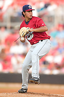 Huntsville Stars starting pitcher Yovanni Gallardo winds up to deliver the ball to the plate versus the Carolina Mudcats at Five County Stadium in Zebulon, NC, Thursday, July 20, 2006.