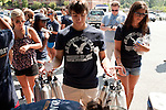 August 20, 2011. Chapel Hill, NC.. Eric Nelson, a UNC sophmore, loads up on water bottles that he and other American Eagle volunteers will hand out to spread awareness of the brand while helping incoming students with their stuff and giving away coupons on move in day.. Many companies have increased their efforts to reach the youth market by employing popular college students to raise the awareness of the brand by peer to peer marketing on campus' around the country.