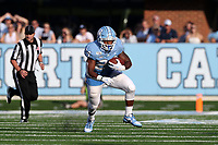 CHAPEL HILL, NC - SEPTEMBER 21: Antonio Williams #24 of the University of North Carolina runs the ball during a game between Appalachian State University and University of North Carolina at Kenan Memorial Stadium on September 21, 2019 in Chapel Hill, North Carolina.
