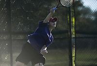 Catholic's Isaiah Bordador serves, Monday, October 11, 2021 during the 6A state girls and boys tennis tournament at Memorial Park in Bentonville. Check out nwaonline.com/211012Daily/ for today's photo gallery. <br /> (NWA Democrat-Gazette/Charlie Kaijo)