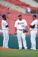 Buffalo Bisons first baseman Luis Jimenez #53 talks with Jose Reyes #7 (left) and Mauro Gomez #18 (right) during a game against the Durham Bulls on June 24, 2013 at Coca-Cola Field in Buffalo, New York.  Durham defeated Buffalo 7-1.  (Mike Janes/Four Seam Images)