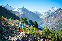 Trail running on the Via Valais, a multi-day trail running tour connecting Verbier with Zermatt, Switzerland. Leaving Zinal and headed for the Turtmanntal