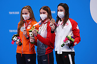 25th August 2021; Tokyo, Japan; Silver medalist ZIJDERVELD Chantalle (NED), gold medalist GONTAR Anastasiia (RPC), and bronze medalist RIVARD Aurelie (CAN) celebrate on the podium for the Swimming : Women's 50m Freestyle - S10 Final - Medal Ceremony on August 25, 2021 during the Tokyo 2020 Paralympic Games at the Tokyo Aquatics Centre in Tokyo, Japan.
