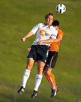 Charlotte Eagles Defender Brady Bryant defends against Bolton Wanderers striker Kevin Davies header.  The Charlotte Eagles currently in 3rd place in the USL second division played a friendly against the Bolton Wanderers from the English Premier League on 7/14/10 losing 3-0.