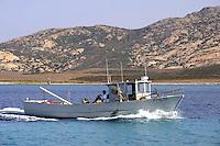 - Sardegna, isola dell' Asinara, peschereccio di fronte a Cala Fornelli.<br /> <br /> - Sardinia, Asinara island, fishing boat in front of Cala Fornelli