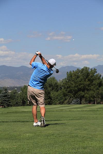 Playing golf, Denver, Colorado,