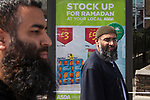 """© Joel Goodman - 07973 332324 . 30/07/2011 . London , UK.  ANJEM CHOUDARY . Islamist group, Muslims Against Crusades, march through Waltham Forest in East London, calling for Sharia law to be imposed in the UK. MAC supporters carried """" Shariah Controlled Zone """" stickers, that have been appearing in parts of East London which have caused concern to some residents. Photo credit : Joel Goodman"""