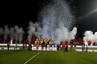 Betar Jerusalem players celebrate the National Cup winning during the final of the Israeli cup against Macabi Haifa, 2008 - 9. Beitar won the cup in a 3 - 0 result. Beitar Jerusalem FC was founded in the 1930's by the right-wing Revisionist Zionist movement, which later formed the Israeli Likud political party, during the British Mandate rule over Palestine. The chanting of the club is racist and mainly against Arabs. The team is the only one in the Israeli league to have never had an Arab player. Beitar is seen as the right wing and Mizrahi (Jews who came from Asia and Africa) club. Photo by Quique Kierszenbaum